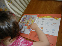 A child using a hidden picture book to practive Visual Processing skills